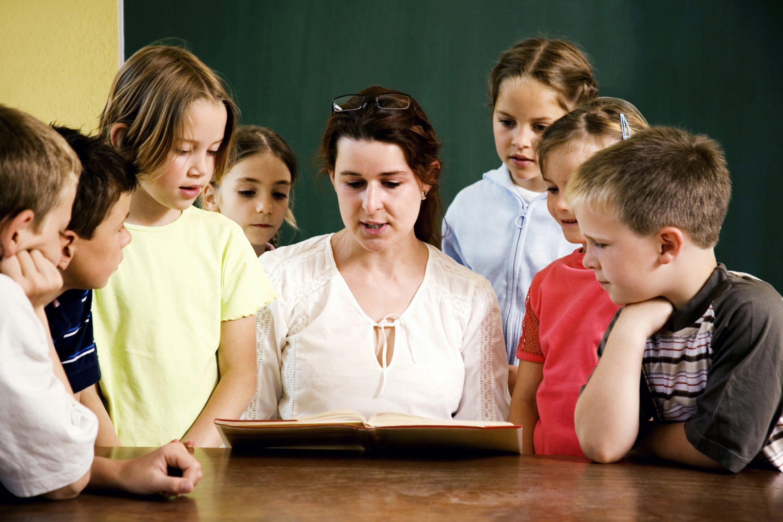 Female teacher reading for her students